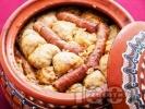 Рецепта Коледна капама със сърми от кисело зеле, пълнени с кайма и ориз, свинско и телешко месо на пържоли и наденица в гювеч